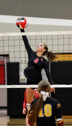 Reagan Schmitz goes up high for a kill attempt during Roland-Story's sweep over Prairie City-Monroe Sept. 3 in Story City.