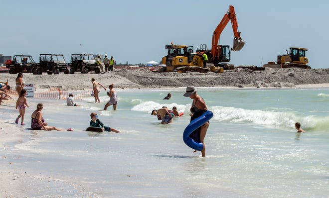 Beachgoers brought volleyballs, turtles and bags for shells to Lido Beach on Labor Day.