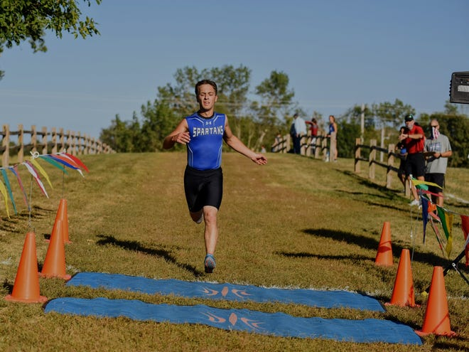 Collins-Maxwell's Kyle Vanderwal is the first runner to cross the finish line in the boys' race at the Spartan Earlybird Invitational cross country meet Aug. 31 at the Center Grove Orchard near Maxwell. Vanderwal won the boys' race with a 5-kilometer time of 18 minutes, 31.8 seconds.