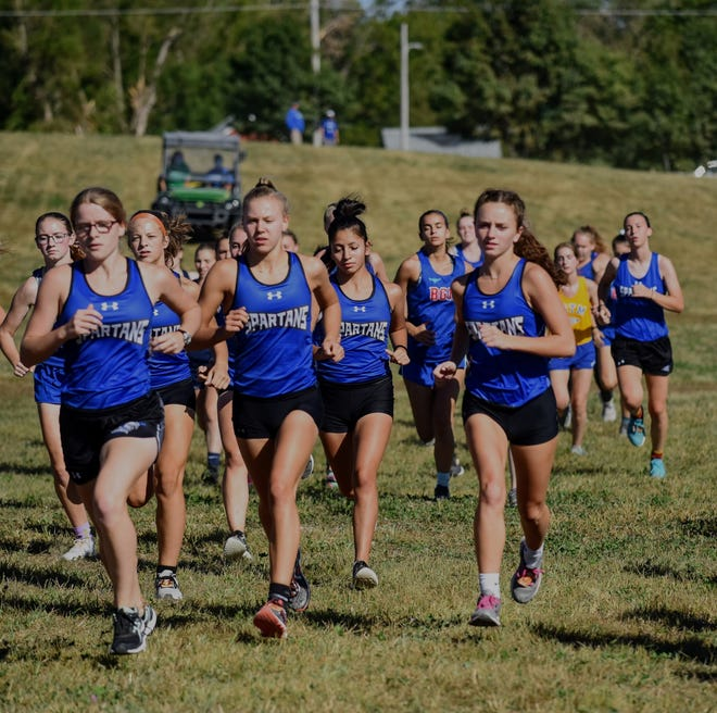 Morgan Day (front), Alexis Houge (middle), Erica Houge (rear left), Karly Ruiz-Genovese (rear middle) and Avery Fricke (right) get out to a strong start for Collins-Maxwell in the 5-kilometer girls' race at the Spartan Earlybird Invitational cross country meet Aug. 31 at the Center Grove Orchard near Maxwell. The Spartans were the girls' team champions at the meet.