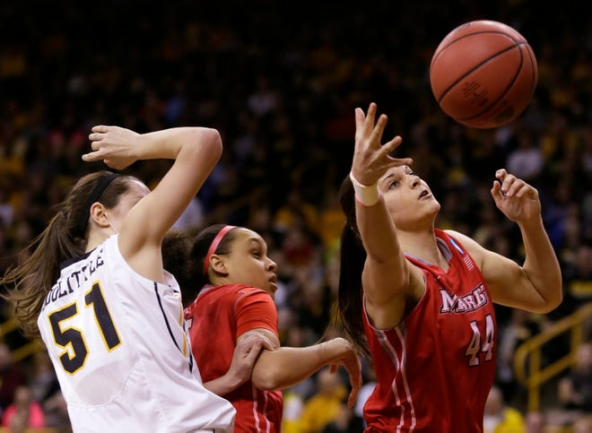 Marist center Tori Jarosz, right, grabs a rebound in front of Iowa center Bethany Doolittle, left, during the first half of an NCAA tournament first-round women's college basketball game, Sunday, March 23, 2014, in Iowa City, Iowa. (AP Photo/Charlie Neibergall)