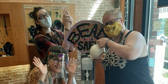 The staff at Beadology pose for a photo in the downtown Iowa City store during the 2020, COVID-19 pandemic.