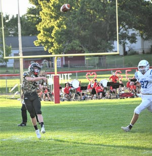 Liberty Union sophomore quarterback Cayden Carroll throws a pass against Bexley during a Week 2 game. Carroll rushed for three touchdowns in Liberty Union's 44-9 victory.