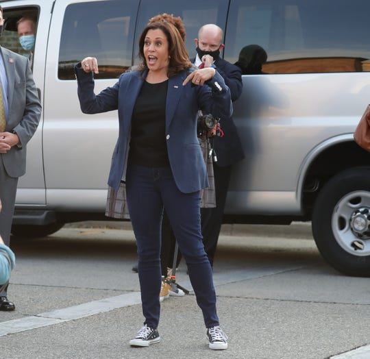 Democratic vice presidential candidate Kamala Harris smiles as she briefly took her mask off to address a crowd of supporters to vote, while leaving JCP Construction, on North Martin Luther King Drive in Milwaukee on Monday.  Harris paid a visit to Milwaukee on Monday to talk to business owners and union members.