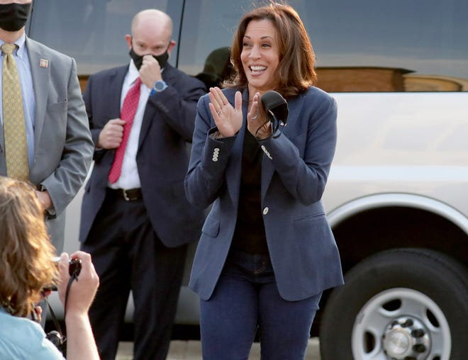 Democratic vice presidential candidate Kamala Harris smiles as she briefly took off her mask to address a crowd of supporters while leaving JCP Construction on North King Drive in Milwaukee on Monday. Harris paid a visit to Milwaukee on Monday to meet with the family of Jacob Blake and talk to Black business owners and union members.