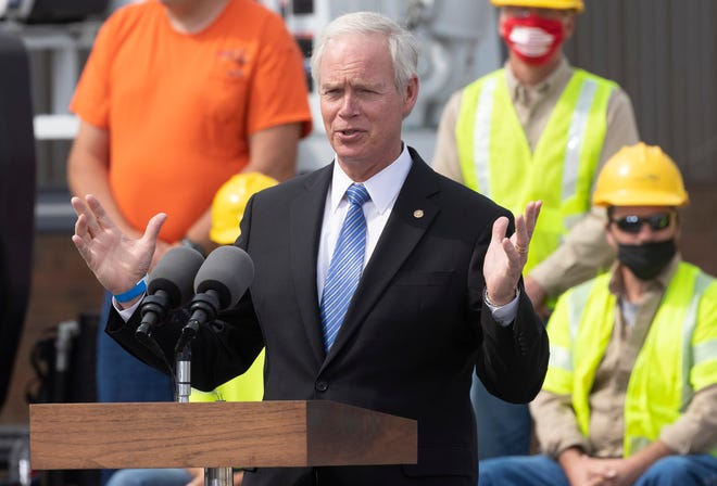 U.S. Sen. Ron Johnson of Wisconsin speaks before Vice President Mike Pence at a campaign appearance at the Dairyland Power Cooperative Frank Linder Service Center in La Crosse on Sept. 7.