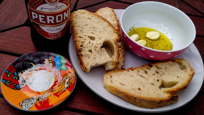 Bread and an oil and herb dip.