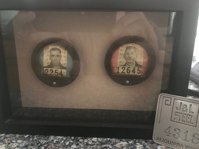 The steel mill badges of my grandfathers and father.