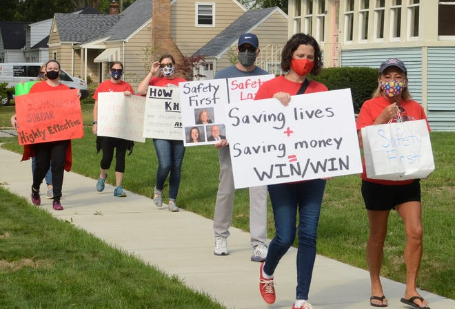 Teachers with the Port Huron Education Association protested along Sanborn Street on Monday, Sept. 7, 2020. They opposed to the district's plan to return to face-to-face learning. With school starting Tuesday, the move follows a contentious debate on how the district should resume class amid the COVID-19 pandemic.