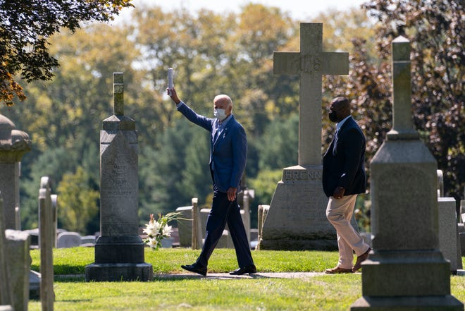Democratic presidential candidate former Vice President Joe Biden waves to media as he leaves St. Joseph On the Brandywine Catholic Church after attending Mass in Wilmington, Del., Sunday Sept. 6, 2020. (AP Photo/Carolyn Kaster)