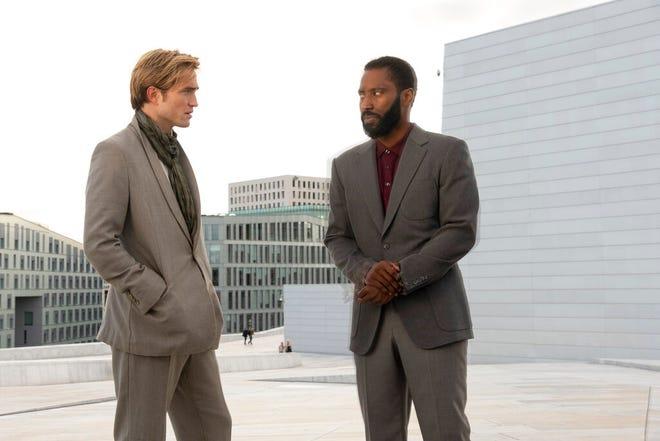 "Robert Pattinson, left, and John David Washington star in ""Tenet."""