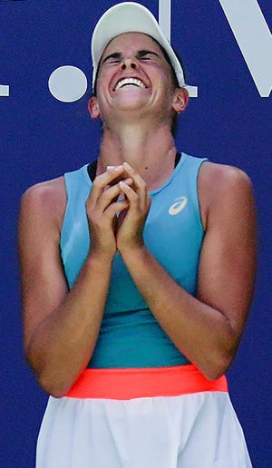 Jennifer Brady, of the United States, reacts after defeating Angelique Kerber, of Germany, during the fourth round of the US Open tennis championships, Sunday, Sept. 6, 2020, in New York. (AP Photo/Seth Wenig)