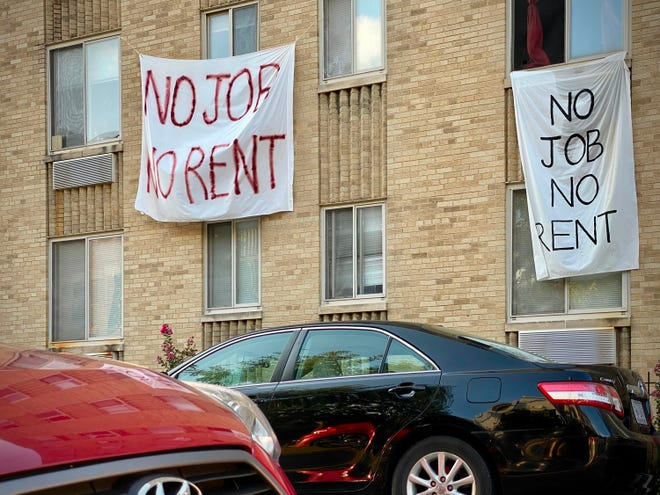 In this file photo banners against renters eviction reading no job, no rent is displayed on a controlled rent building in Washington, DC on August 9, 2020. Applications for U.S. unemployment benefits fell last week. (ERIC BARADAT/AFP via Getty Images/TNS)