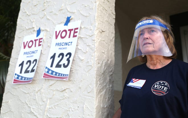 Pjnellas County poll worker Jeanne Coffey wears a protective shield as she works the front door at the Coliseum Ball Room in St. Petersburg, Florida, on August 18, 2020, as voters cast ballots in the primary election. (Scott Keeler/Tampa Bay Times/TNS)