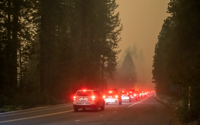 Wind and flames leap high in the air forcing hundreds to evacuate on Sunday, Sep. 6, 2020.