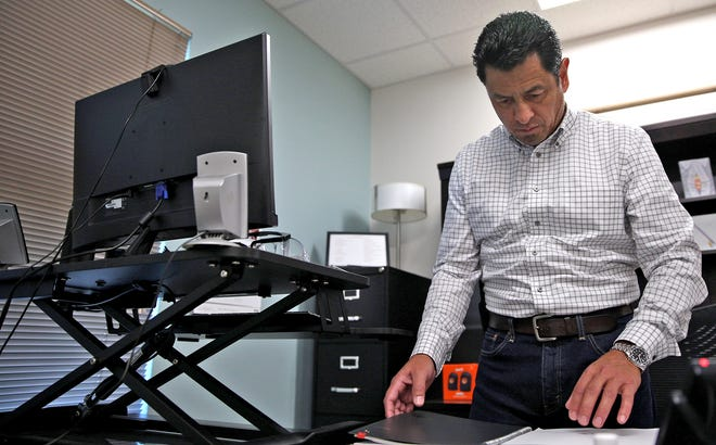 Eric Sanchez, CEO of The Alcohol and Drug Abuse Council of the Concho Valley, works in his office Thursday, Sept. 4, 2020.