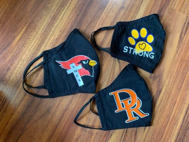Face masks created by Amanda Roth feature Dell Rapids, St. Mary and Baltic logos.