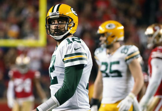Green Bay Packers quarterback Aaron Rodgers (12) reacts against the San Francisco 49ers during the second half in the NFC Championship Game at Levi's Stadium.