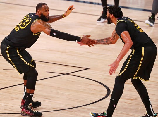 LeBron James and Anthony Davis combined for 62 points in the Lakers' Game 2 win.