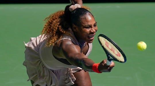 Serena Williams returns a shot to Maria Sakkari of Greece on Monday.