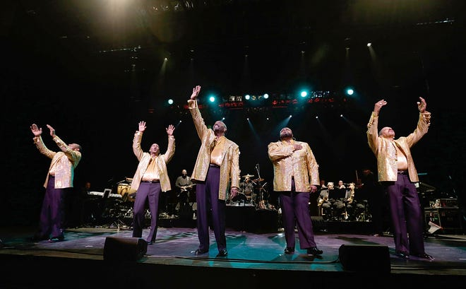"""Joe Herndon (from left), Terry Weeks, Otis Williams, Bruce Williamson and Ronald Tyson of The Temptations perform during """"The Temptations and The Four Tops on Broadway"""" at Palace Theatre on Dec. 29, 2014, in New York City."""