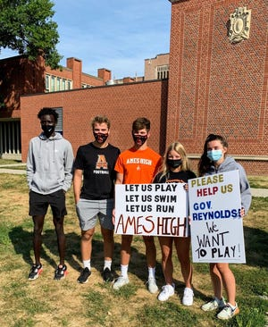 Ames student-athletes (left to right) Aniey Akok, Jackson White, Brady Burkheimer, Caroline Waite and Ellie Lynch marched with Des Moines high school student-athletes on Monday in Des Moines. They were protesting being denied the chance to participate in extracurricular activities as their schools go to all-virtual learning due to COVID-19 concerns.