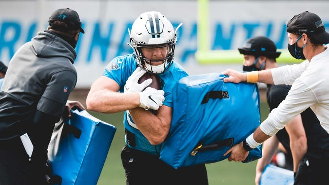 Archbishop Wood graduate Colin Thompson goes through a drill during Carolina Panthers camp.