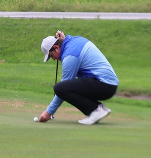 Connor Humble marks his ball during the Ernotte Hiller Tournament last September. Humble tied for 69th to lead the Minnesota Crookston men's golf team at the Mule Invitational this week.