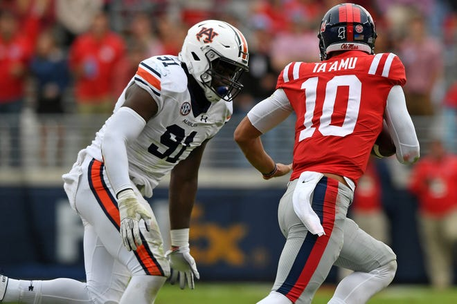 Auburn's Nick Coe gives chase to Mississippi quarterback Jordan Ta'Amu during a game in the 2018 season.