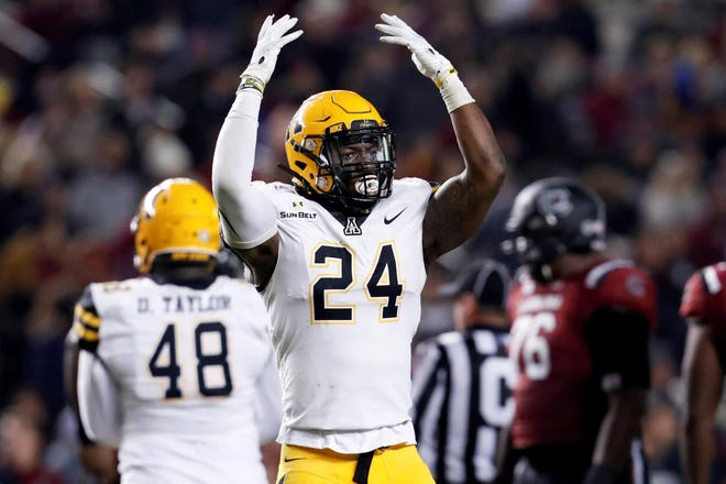 Appalachian State's Akeem Davis-Gaither celebrates during the Mountaineers' 20-15 win over South Carolina on Nov. 9 at Williams-Brice Stadium. [Jeff Socho/Tim Cowie Photography]