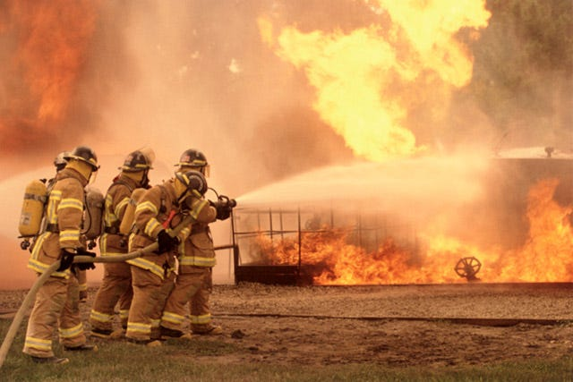 Multiple firefighters working
