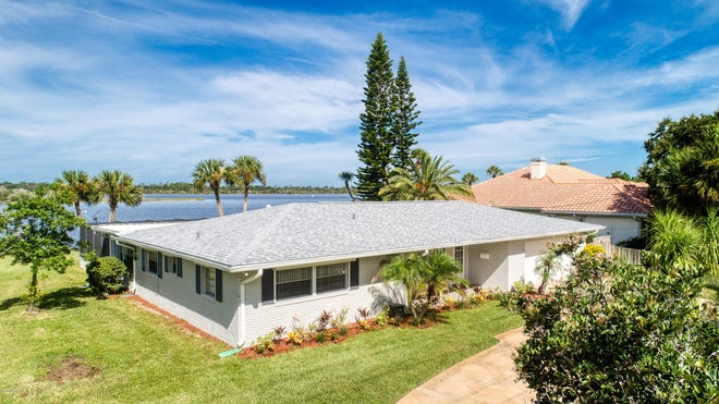 Enjoy amazing sunsets, gorgeous views, boating, fishing, wildlife and nature from this totally-renovated waterfront pool home, within walking distance of the beach on prestigious John Anderson Drive.