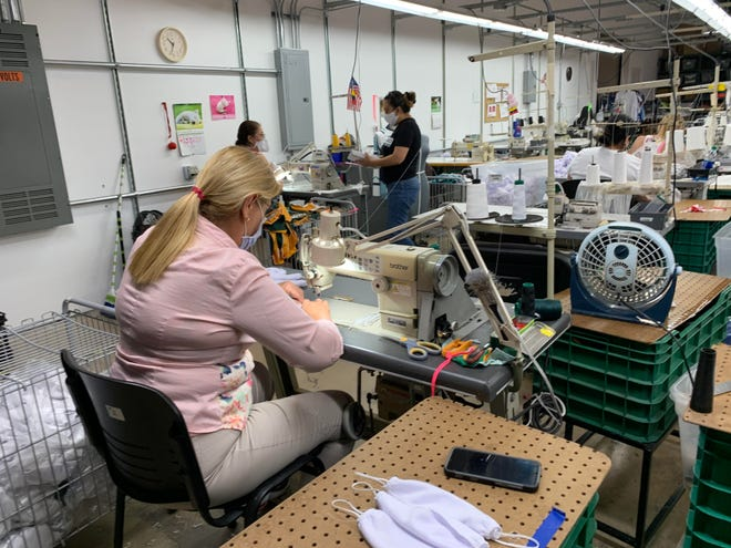 FitUSA Manufacturing workers produce face masks at the coimpany's Ormond Beach plant on March 20, 2020.