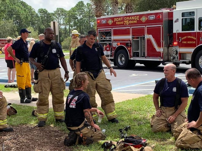 Port Orange and New Smyrna Beach firefighters take a break during an August joint training session. Port Orange firefighters are seeking better pay and benefits and are expected to hold a protest outside City Hall prior to the City Council meeting, where council members aim to set the tentative tax rate.