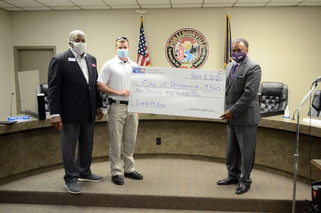 Capital Area United Way CEO George Bell presents a check to Donaldsonville Fire Chief Adam Gautreaux and Donaldsonville Mayor Leroy Sullivan Sept. 1 at City Hall. The $2,300 grant will be used for personal protective equipment for first responders working for the fire department.