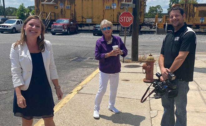 WAFB anchor Lauren Westbrook, LSU gymnastics coaching legend D-D Breaux, and photographer Brandon Shackelford pose for a photo in front of The First and Last Chance Cafe in Donaldsonville.