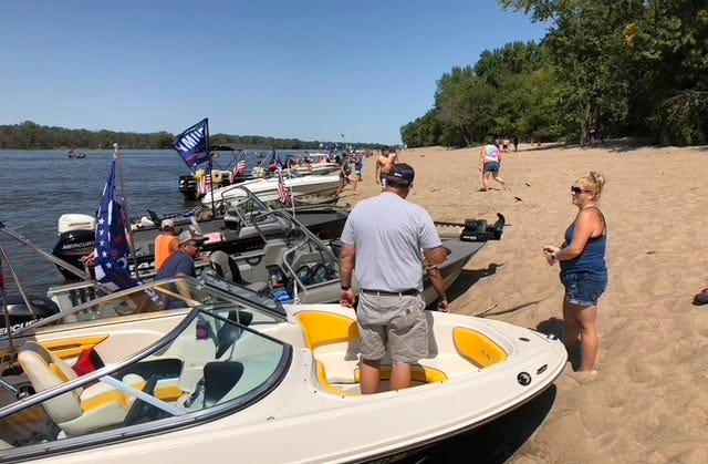 The Muscatine Trump 2020 Boat Parade organizes on Bass Island on Sept. 5 on the Mississippi River below Muscatine.