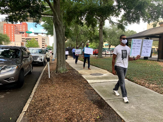 Activists demand the Elections Supervisor Mike Hogan expand voting options in Duval County.