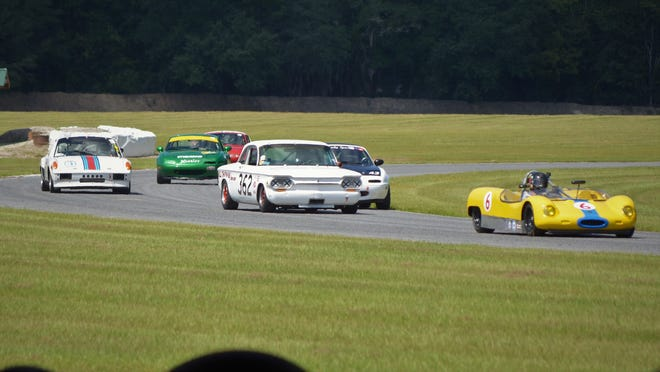 Classics in motion at a recent Vintage Drivers Club of America race at Savannah's Roebling Road Raceway.