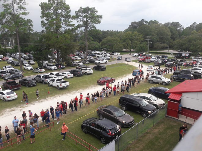 Fans line up for nearly half a block outside Memorial Stadium before a high school football game Sept. 4 between Baker County and Bradford.