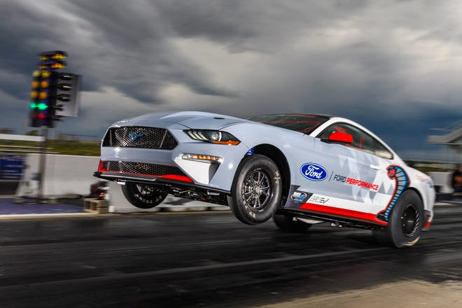 The all-electric Ford Mustang Cobra Jet 1400 prototype did a wheelie as it laid down a quarter-mile time of 8.826 seconds at 156.81 miles per hour, and reached 1,502 peak wheel horsepower in recent private testing.