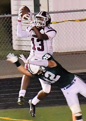 Woodridge wide receiver Kamari Mitchell snags a catch in the end zone during the Bulldogs' 38-35 loss at Cloverleaf Sept. 4.