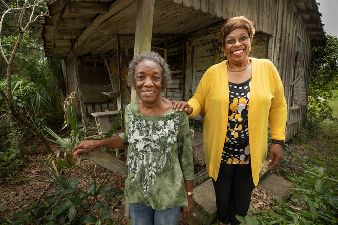 Vera Owens, left, and her sister, Precious Baker, stand on the porch next to the cabin their great-grandfather Alfred Beal helped to build for his daughter on the Beal family homestead in Bealsville. A former slave, Alfred Beal is the namesake of the community in eastern Hillsborough County.