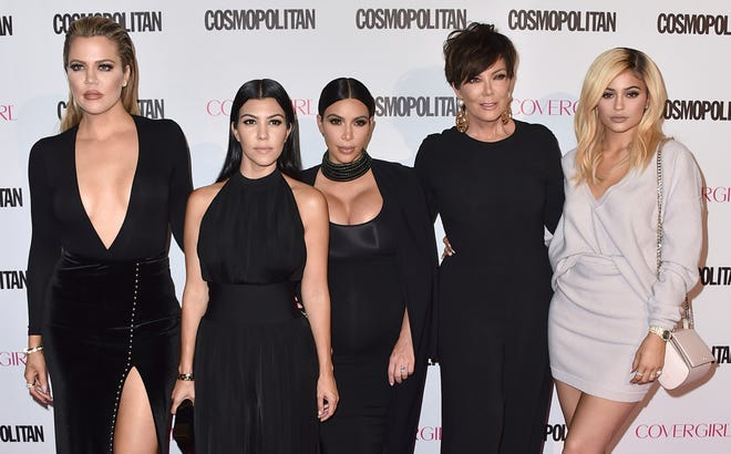 """Khloe Kardashian, from left, Kourtney Kardashian, Kim Kardashian, Kris Jenner and Kylie Jenner arrive in October 2015 at Cosmopolitan magazine's 50th birthday celebration in West Hollywood, Calif. After more than a decade, """"Keeping Up With the Kardashians"""" is ending its run."""