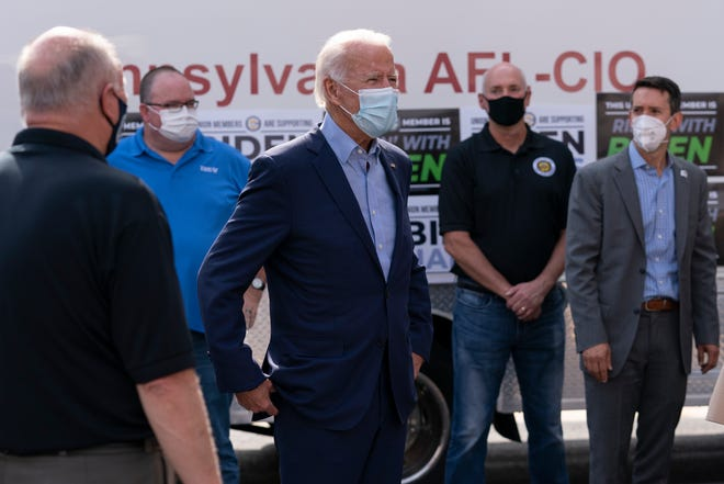 Democratic presidential candidate former Vice President Joe Biden talks with union leaders after taking photographs outside the AFL-CIO headquarters in Harrisburg, Pa., on Monday.