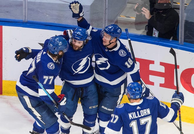 Tampa Bay Lightning's Victor Hedman (77), Brayden Point (21), Ondrej Palat (18) and Alex Killorn (17) celebrate a goal during the second period against the New York Islanders in Edmonton, Alberta, on Monday.