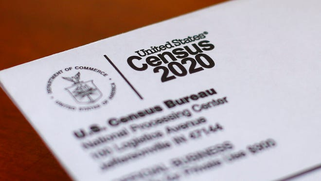 This Sunday, April 5, 2020, photo shows an envelope containing a 2020 census letter mailed to a U.S. resident in Detroit.  The U.S. Census Bureau has spent much of the past year defending itself against allegations that its duties have been overtaken by politics. With a failed attempt by the Trump administration to add a citizenship question, the hiring of three political appointees with limited experience to top positions, a sped-up schedule and a directive from President Donald Trump to exclude undocumented residents from the process of redrawing congressional districts, the 2020 census has descended into a high-stakes partisan battle.