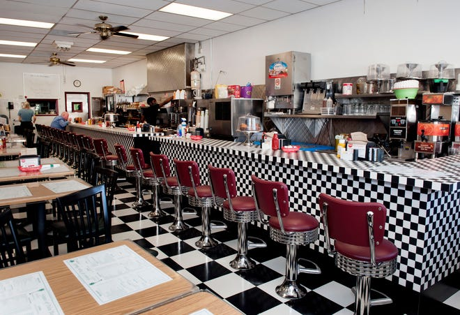 Green's Pharmacy Luncheonette in Palm Beach has a new look that includes a new counter and floor, both with a classic black-and-white checkerboard pattern.