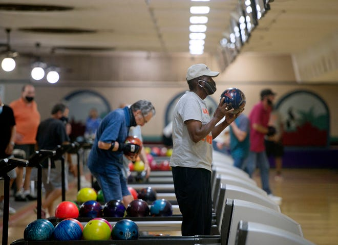 Verdes Tropicana Bowling Lanes opened for the first time in six months in West Palm Beach September 8, 2020. The popular bowling alley has been closed because of the Covid-19 pandemic. Only four people can bowl at one lane and there must be an empty lane between groups. [MEGHAN MCCARTHY/palmbeachpost.com]
