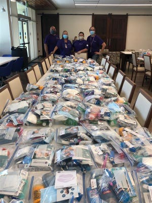 Staff with Stockton PACE assisted the city of Oakdale assemble care kits for wildfire victims.